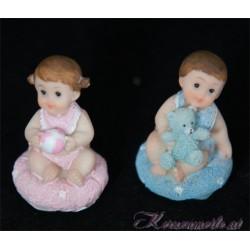 Tortenfigur Baby auf Kissen